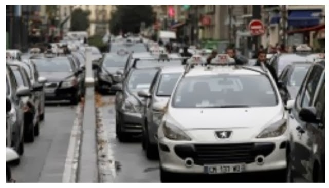 Paris Taxi Trade Show London How It's Done: More than 5000 taxis ready to block Paris today.